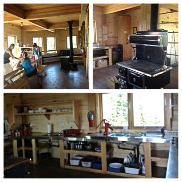 The first floor of the Fowler/Hilliard Hut contains a kitchen area, a huge table for communal meals, additional seating areas and a wood stove.