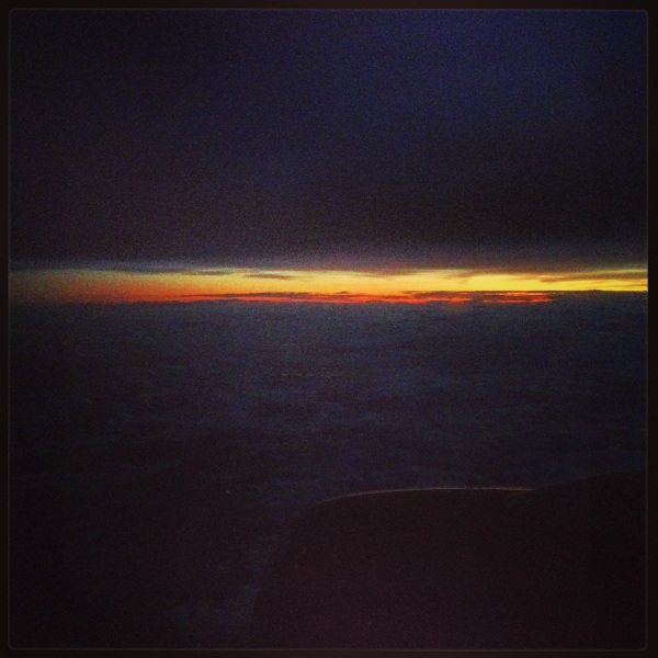 The sunset as seen from my window seat was more beautiful than this photo lets on.